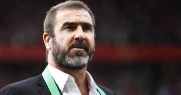 New York Cosmos manager Eric Cantona stands on the pitch before a testimonial soccer match for former Manchester United player Paul Scholes at Old Trafford Stadium, Manchester, England, Friday Aug. 5, 2011. (AP Photo/Jon Super) NO INTERNET/MOBILE USAGE WITHOUT FOOTBALL ASSOCIATION PREMIER LEAGUE(FAPL)LICENCE. EMAIL info@football-dataco.com FOR DETAILS.