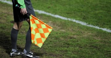 A line referee stands beside the line during the French Cup football match Metz vs. Evian-Thonon-Gaillard on January 8, 2012 at the Saint Symphorien stadium in Longeville-Les-Metz. AFP PHOTO / JEAN-CHRISTOPHE VERHAEGEN